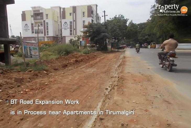 BT Road Widening near Apartments in Tirumalgiri