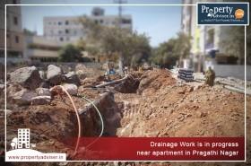 Drainage Work is in progress near apartment in Pragathi Nagar