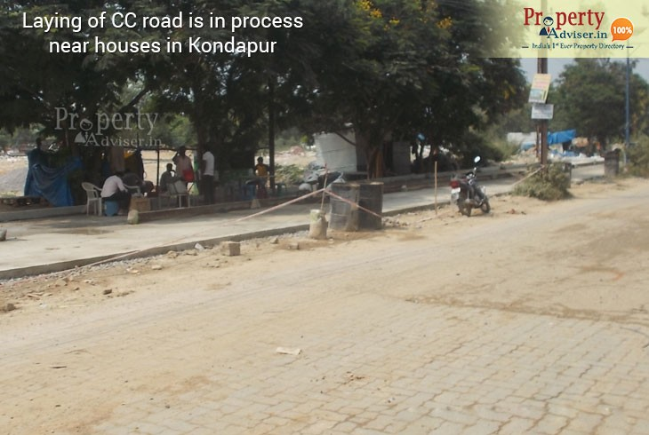 Laying of CC road is under process near Residential houses in Kondapur